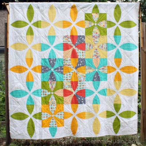 Picnic Petals: a modern quilt on the traditional flowering snowball quilt block. An easy curved pattern by Whole Circle Studio. This version mixes Michael Miller fabric prints with solid fabric. Makes a lap, throw, twin or queen size quilt.