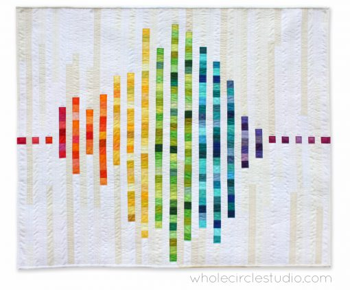 "Inspired by frequency waves, Modern Love is an abstract interpretation of what the word ""love"" might sound like. This tested pattern contains both detailed instructions and diagrams, making it easy to piece. Instructions are provided for three sizes: Wall, Throw and Queen. Included in this pattern are row locations for all of the fabric pieces so additional colors and/or prints can be added. This scrappy version features a rainbow color palette made entirely from my stash!"