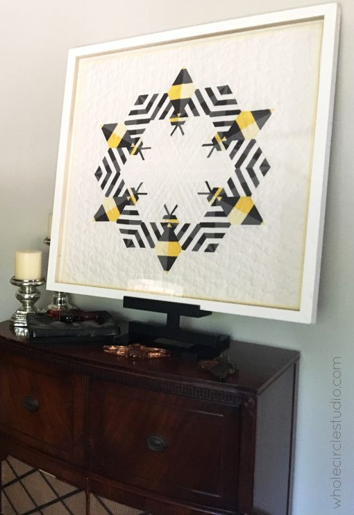 Bzzzzzz (bee) quilt framed for home, hospitality, hotel decor. Custom licensed art by Sheri Cifaldi-Morrill of Whole Circle Studio.