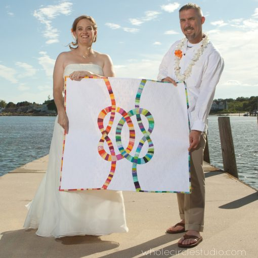 Heirloom Double Wedding Knot quilt made by Sheri Cifaldi-Morrill, Whole Circle Studio. A one of a kind, custom wedding quilt gift.