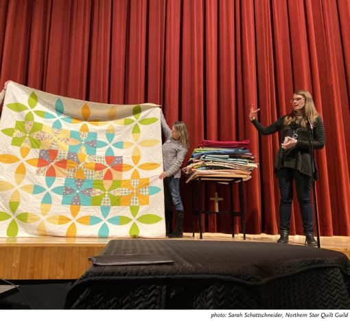 Sheri Cifaldi-Morrill of Whole Circle Studio presenting her modern quilt trunk show, including her Picnic Petals quilt, to the Northern Star Quilt Guild in Somers, NY.